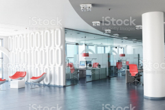 Very realistic 3D rendering of a modern corporate office in white, glass and red